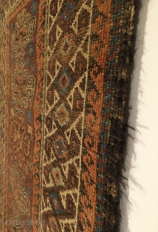Baluch Rug. Symmetrically knotted group. Hooked medallions float on madder field surrounded by bird pinwheel border.  Last Quarter 19th Century.  Beautiful kilim ends.  6 colors.  51 x 31.5.  ...