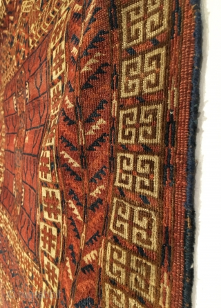 Tekke Ensi.  Mid 19th Century.  Tree border and alternating 'candelabra' kush design.  This piece is a predecessor to the more precise weavings of the latter period.  6 colors.  ...