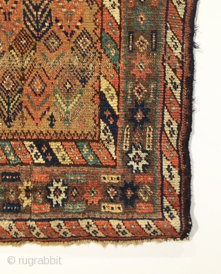 Kurd rug.  Floral field design.  Inscription top right corner: 1274 = 1857?. Very good condition considering age.  One localized line of visible wear.  7 colors including purple.   ...