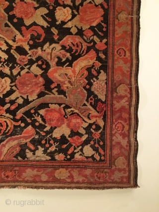 Karabagh Rug.  Circa Antique.  Flowers on a chocolate brown field.  Condition: Good.  Repaired slits in right border.  Slight loss to top.  Even wear.  5 colors.  ...