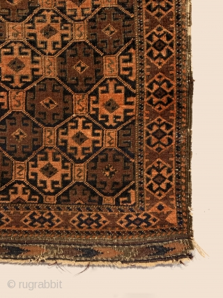 Antique Small Baluch Rug. Circa Early. Tribal guls enclosing hooked devices and 'S' dragon motifs arranged in a tiled latticework pattern decorate this early Baluch rug. Natural orange and purplish madder on a  ...