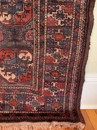 Turkmen Main Carpet. Circa Antique. Afghanistan. The 'aina gochak' main border frames a 4x7 gul layout of varying size on a rare purple ground. An interesting 'gurbaghe' secondary gul. Radiating bird heads.  ...