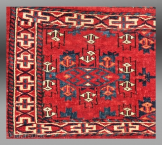 """Yomut Group Torba, Central Asia, circa 1900 or before(?), 2'11"""" x 1'4""""  Asymmetric knot open right  Cotton weft (white with some blue)  Good condition, no repair, complete with hanging cords and flat woven back  Saturated clear  ..."""