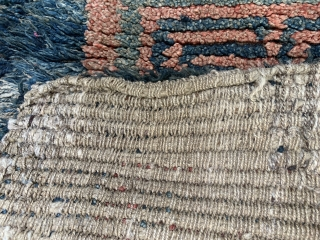 Quite rare and powerful monastic Tibetan seat rug with a square central symbol that shrinks in five steps to the centre. A running dog variant as a border. I would date the  ...