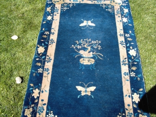A good, honest pre-WW2 Chinese rug about 3x5 (36 by 66 inches), medium to low pile all over, dirty, end erosion but not into the pattern. The typical (meaning real) blue and  ...