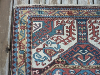 "1880 Kasim Ushak Kazac 57"" x 79"" needs a little work on side edges and has loss to one corner as shown    $1700 plus shipping"