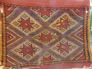 Kilaz Heybe, SOLD ,*Thank you.knotted Anatolian saddlebag, 20 x 18 inches. Good pile, four tiny holes visible in the last picture where it is held to the light SOLD, *Thank You