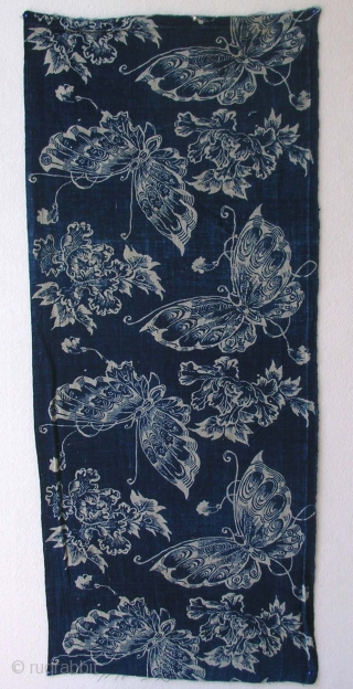 Katazome panel, Japan, early Meiji (circa 1870), cm75x33. This is a  Katazome  a cloth with a repeated pattern of butterfly and peony motif on a  sky blue indigo ground.  ...