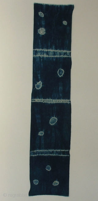 """Indigo shibori panel, Japan, Taisho (c.1920), 165x33cm. The common English translation of the Japanese word shibori is """"tie-dye""""; however, a more accurate translation is """"shaped-resist dyeing,"""" which describes the inherent patterning process  ..."""