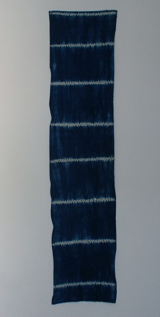 """Indigo shibori panel, Japan, Taisho (c.1920), 151x33cm. The common English translation of the Japanese word shibori is """"tie-dye""""; however, a more accurate translation is """"shaped-resist dyeing,"""" which describes the inherent patterning process  ..."""