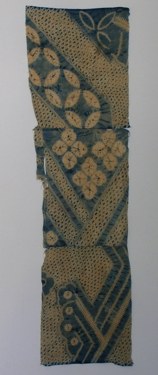 "Indigo shibori cloth , Japan, late Meiji (c.1910), 101x27cm. The common English translation of the Japanese word shibori is ""tie-dye""; however, a more accurate translation is ""shaped-resist dyeing,"" which describes the inherent  ..."