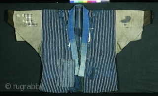 BORO noragi, Japan, late Meiji (circa 1900), cm 82x130. This is an handsome noragi (work coat) made of recycled indigo dyed cottons; in other words it is a 'boro' jacket that was  ...