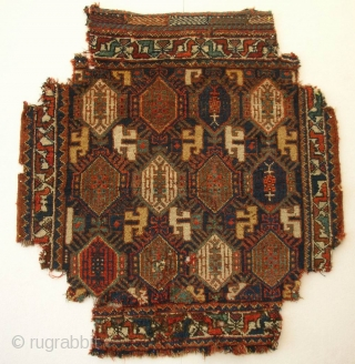Qashqa'i khordjin, south west Persia, second half 19th century, cm 77x72. A superb bagface with bit of condition issues. Having been used as upholstery (!), it is now missing corners as you  ...