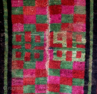 Mat, Tibet, early 20th century, cm 70x55. Tibetan rugs in so-called 'tsuk-truk' technique (woven in narrow stripes - then joined - on small back strap looms) are probably the survivors of a  ...