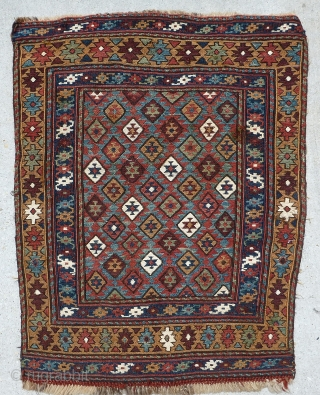 Antique Shahsavan / Shahsevan bag faces of a rare diamond lattice and star field with a yellow gold border. Wool construction with cotton whites. Floppy handle except corner repairs.