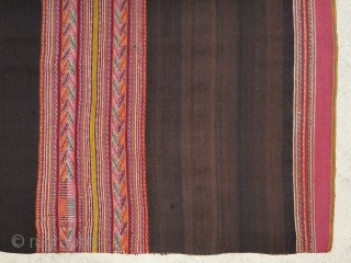 Antique Aymara or Quechua manta textile from Peru or Bolivia. All wool construction with beautiful colors. Beautiful natural brown abrashed field.