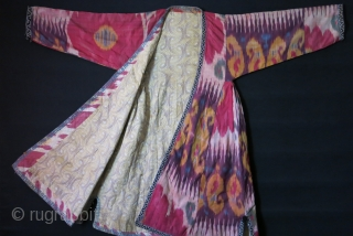 """Uzbekistan Shoi - silk/ on silk quilted Chapan. Adras ikat facing and Printed cotton lining. very small minor holes in several places. Circa 1900 - size: Arm to arm 66"""" - 168  ..."""