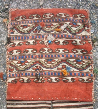 Very old anatolian Heybe. 43 x 144 cm. Used. In the middle holes and repairs.