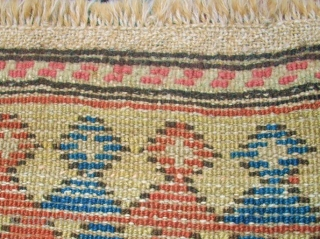 Antique caucasian rug. Size: 116 x 222 cm. At one end some low pile. Interesting rug.