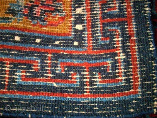 Pair of Tibetan / Chinese rugs. Size: 66 x 60 cm and 66 x 61 cm.