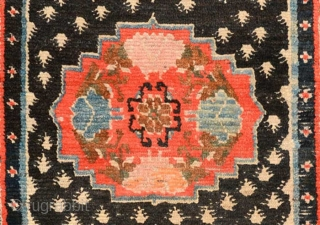 Strikingly vibrant Tibetan khaden with three medallions and the so-called 'frog foot' design scattered throughout the center field. The main border is a well executed interlocking yungdrung (swastika) design with an almost  ...