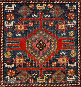 An exquisite Kurdish pile-woven mafrash panel from the far North West of Persia (Iran) or the far southern Caucasus with a double medallion design center and multiple borders with a wide strip  ...