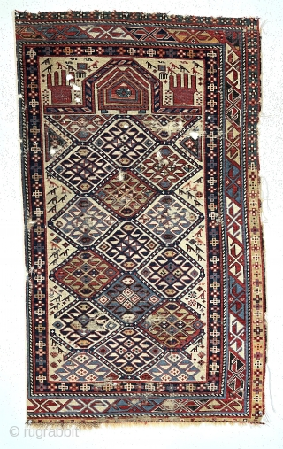 Antique ivory ground Caucasian prayer rug. Probably shirvan with some interesting features including many animals and a well drawn mihrab with hands (although only 4 fingers?). Overall even low pile with  ...
