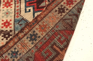 """Antique Turkish yastik. Bold design. All natural colors with beautiful abrashed blue ground. Wear and edge loss. Clean. ca. 1880 or earlier. 21"""" x 31""""."""