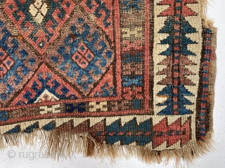 Antique jaf Kurd bagface with some interesting features but in very rough condition. This older example has a somewhat larger scale field and both uncommon main and minor borders. The diamond lattice  ...