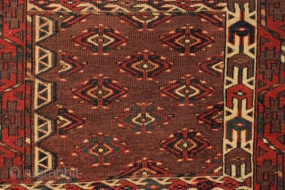 Antique Yomud ensi with good design and excellent old colors. First rate elem panels. No repairs. Overall low even pile. Floppy handle. Edges rough, small gouge. Palm sized wine stain. All natural  ...