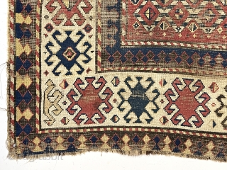 "Early Kazak rug with a very unusual field design. The weaver created a novel eye dazzling ""candy cane"" lattice field and used traditional bold Kazak borders. All very good natural colors featuring  ..."