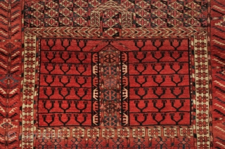 Antique Tekke ensi with rich red ground, glossy wool, and vibrant electric blue highlights. Mostly good even pile with scattered light wear. No repairs. All natural colors. Reasonably clean. Text book example  ...