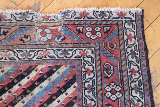 Antique northwest persian or kurdish long rug. Nice design. Fresh off a New England floor. All natural colors with great old purples. Condition as shown, a bit dirty with some wear as  ...