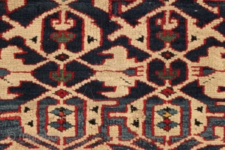 "Antique caucasian Konaghend rug. Highest quality weaving. Possibly attacked by wolves. Thick glossy high pile but both end borders damaged. Numerous scattered chewed spots very crudely ""repaired"". All is not lost as  ..."