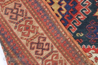antique kazak rug with an interesting compartment design. All natural colors featuring a good saturated tomato red and nice deep greens. Mostly good pile with some wear and brown oxidation as shown.  ...