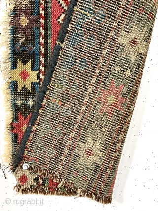 """Antique little fragment of an older caucasian rug with beautiful old colors. Delicate drawing and deep brown oxidation. Lovely old purples, greens and yellows. Mid 19th c. 13"""" x 33"""""""