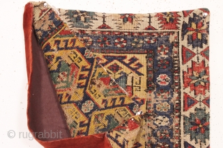 """Old soumak rug fragment made into a pillow. All natural colors featuring a nice yellow ground. I opened one end and removed the old stuffing. 19th c. app. 20"""" sq."""