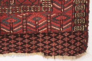 """older tekke ensi in fair condition with some nice greens. Mostly good pile. Good quality wool. All natural colors. Imperfect and priced accordingly. ca. 1875. 3'11"""" x 4'10"""""""