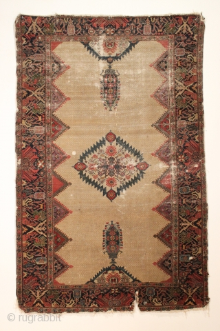 Antique Persian Farraghan rug. Wonderful old rug in abused condition. Holes, gouges, tears, etc. Beautiful colors including grape purples, nice reds and characteristic Farraghan greens. Reasonably clean and structurally sound. Rare weaving.  ...