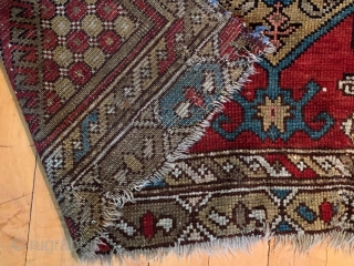 Old large Caucasian rug. Interesting design reminiscent of early karrabaugh pieces. New England rug, as found, dirty, worn and rough as shown. I see one sewn up crease. Selvages all trimmed and  ...