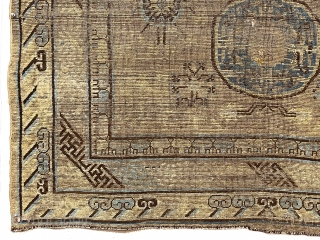 Early grand weaving, presumably Chinese, possibly kangxi, intact but thin with very low pile. Truly majestic wall piece with spacious archaic field design and beautiful eye catching borders. Small tear in upper  ...