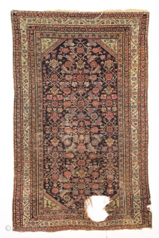 """Antique ferrahan rug with interesting design elements but unfortunately damaged by a cannonball. All good colors featuring that nice characteristic apple green. Many little animals and charming humans. Selling """"as found"""", very  ..."""