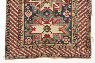 antique caucasian rug, probably shirvan, with bold Lesghi stars and an eye catching border. All natural colors featuring lovely greens and lots of a good old yellow. As found, not restored, with  ...