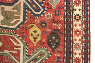 Antique lenkoran long rug in overall good condition. Classic design done with a flare, the angled medallions seem to be swimming and wiggling down through the field. Vibrant all natural colors including  ...