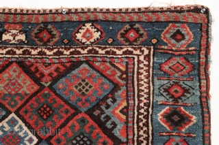 Antique Jaf Kurd bagface. Fine color and good design featuring an unusual light blue border. Large range of good natural colors. Mostly has nice thick pile, center has lower pile as shown.  ...