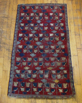 Antique caucasian rug. Another mystery rug. Interesting but very rough condition. Heavy oxidation. Low pile and wear. Edges not original. Small holes. Old burlap backing sewn on and mostly removed. Natural colors?  ...