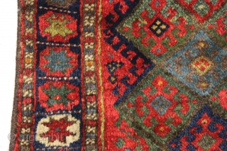 """antique jaf kurd bagface with thick high pile and beautiful saturated colors. Highest quality glossy wool. Unusual wide format and an attractive """"star"""" border. All natural colors featuring lovely greens. One of  ..."""