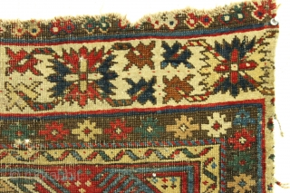 "Antique little caucasian rug fragment. Diminutive. Older ""keyhole"" type. All good natural colors. Rough and dirty condition as shown.  ca. 1875, probably older. 2' x 2'3"""