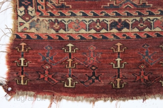 antique turkman yomud chuval. Older example unfortunately ravaged by wolves. Nicely drawn field and better than average elem panel. All natural colors. As found condition and priced accordingly. Ca. 1870 or earlier.  ...