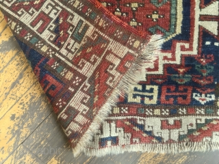 """Antique kazak or Karabaugh rug. Interesting field. Fair condition. Even low pile. Good selvages. End loss as shown. Needs a wash. Charming little rug. Late 19th c. 3'3 x 5'5"""""""